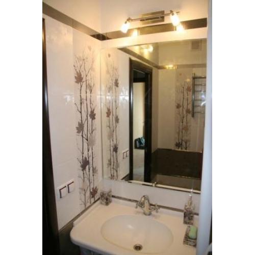 Quel carrelage pour agrandir une salle de bain besancon for Bineau mural levallois perret